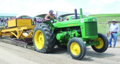 Antique tractors roar to life in Denzil