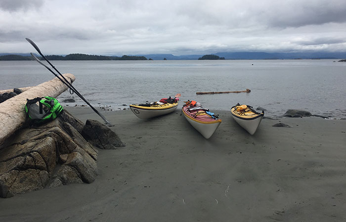 Lunch was spent on Turret Island's best beach, with dark clouds on the horizon. We were well prepared for the weather, which has been wet and cool this early summer off British Columbia's west coast. Photo by Mike Robinson