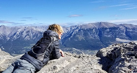 Travel Like This editor Lisa Monforton gazing over Ha-Ling-Peak Canmore Alberta